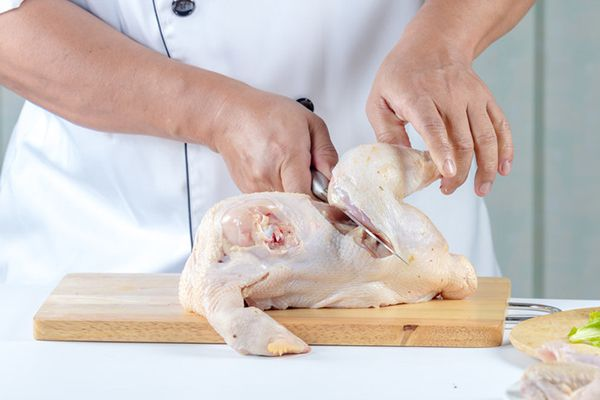 This image has an empty alt attribute; its file name is ChickenWithKnife_fotosearch_600.jpg