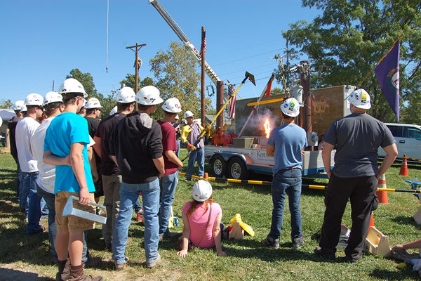 David White, safety instructor for the Kentucky Association of Electric Cooperatives, performs a safety demonstration at Construction Career Day at the Shelby County Fairgrounds. Shelby Energy participates in the event every year. Photo: Laurie Gutermuth