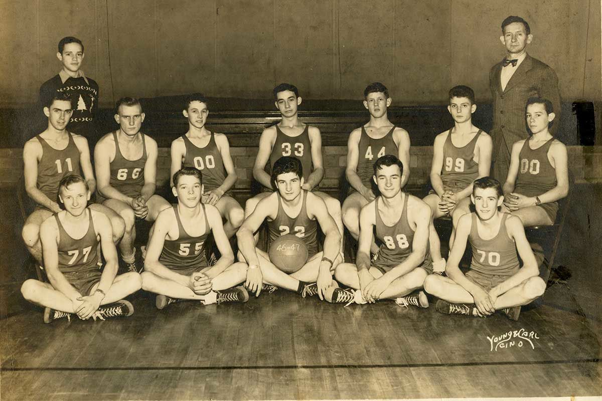 Paul Gordon, number 00 seated third from left in the back row, played four years of high school basketball, was awarded three basketball letters, a perfect attendance medal, and served as team captain his last two years.