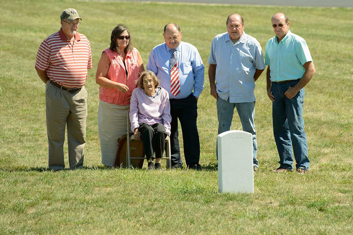 The Gordon family gathers in September at Sgt. Paul Gordon's final resting place at Kentucky Veterans Cemetery North in Williamstown.