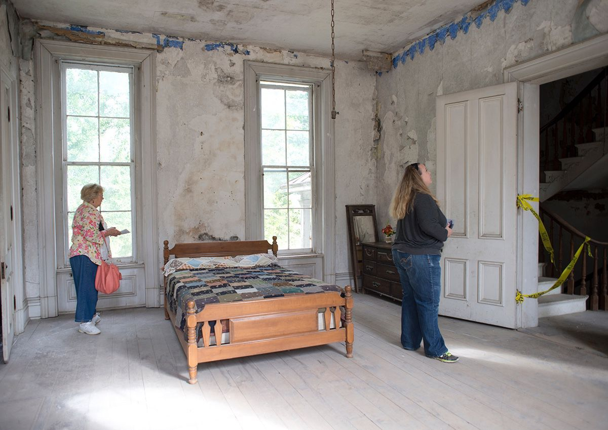 Visitors gather to explore the Master bedroom