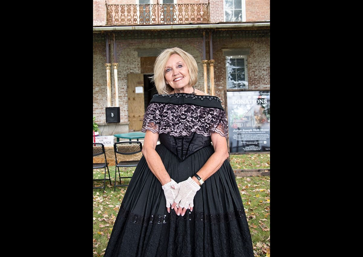 Susan Dyer President of Friends of Holt home modeling a dress from the period.