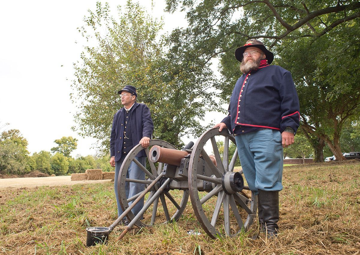 Bruce Austin and Gordon Brandenburg of the 14th light Artillery prepare the cannon