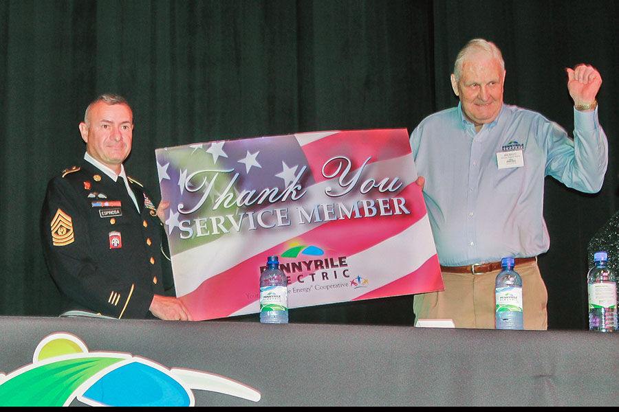 Sgt. Maj. Gabriel A. Espinosa Jr. receives a thank you note from Pennyrile Electric