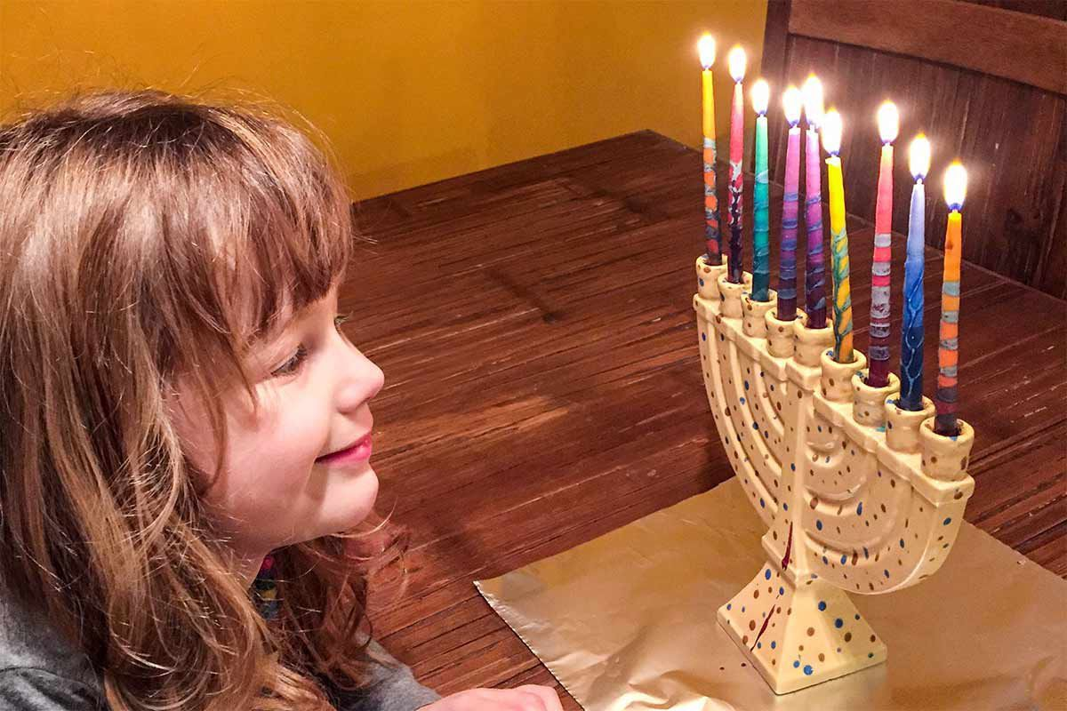 Enjoying light of the menorah