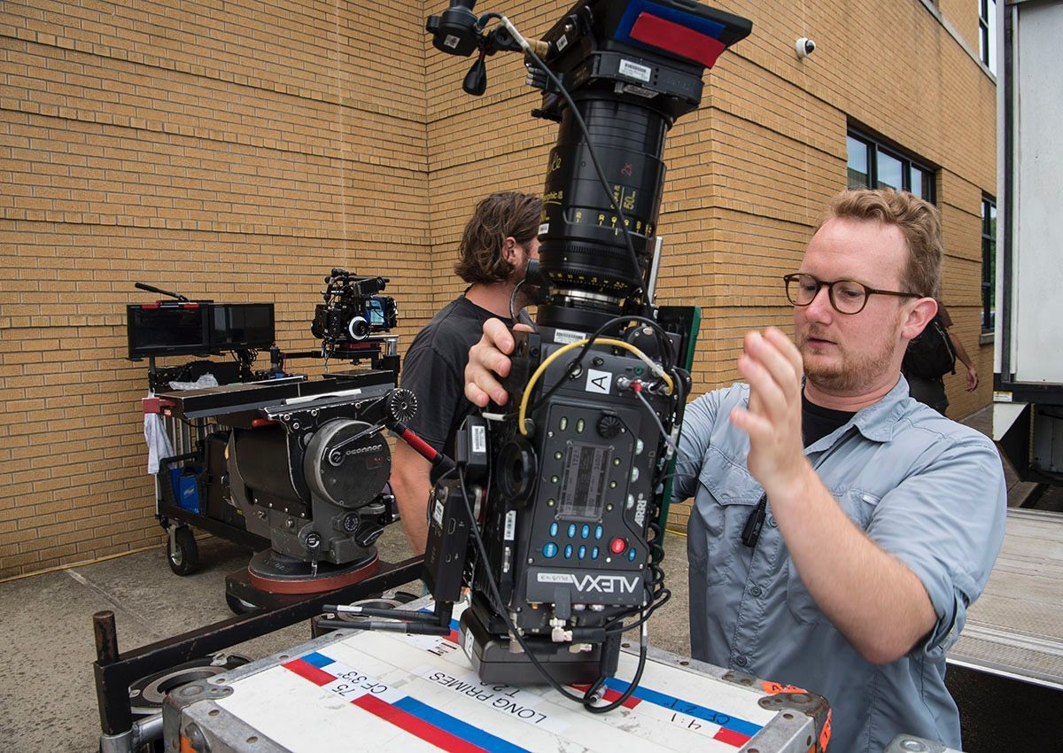 """Camera assistant Chris Geukens of Los Angeles sets up a camera and loads in equipment for the movie """"Tragedy Girls"""""""