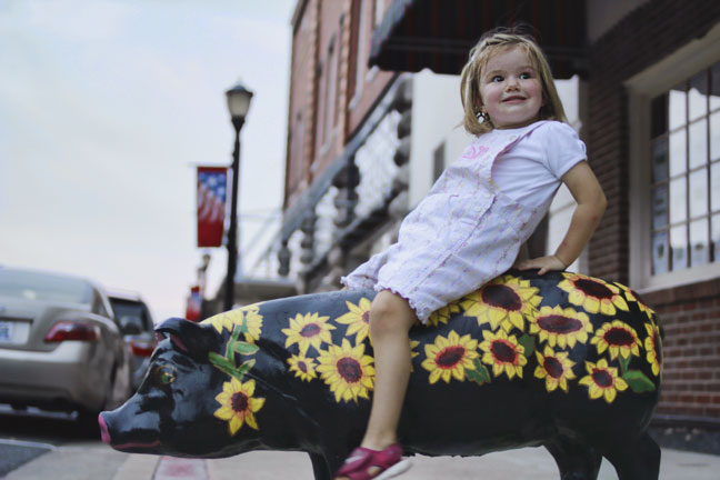 little-girl-on-downtown-concrete-pig